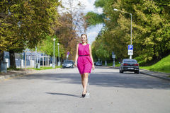 Beautiful young blonde woman in red dress Royalty Free Stock Photography