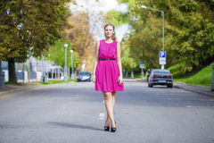 Beautiful young blonde woman in red dress Stock Photo