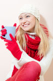 Beautiful young blonde woman in red knitting Royalty Free Stock Photos