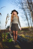 Beautiful young blonde woman in rural background Royalty Free Stock Image