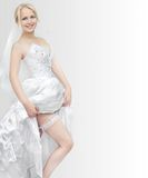 Beautiful young blonde woman showing a garter Royalty Free Stock Photo