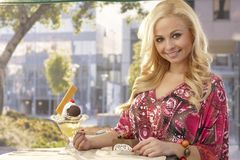 Beautiful woman at outdoor cafe Royalty Free Stock Image