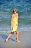 Beautiful young blonde woman in sundress on beach Royalty Free Stock Images