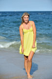 Beautiful young blonde woman in sundress on beach Stock Photography