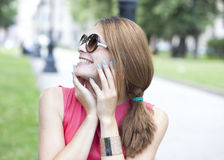 Beautiful young blonde woman in sunglasses Stock Photo