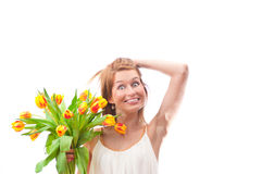 Beautiful young blonde woman with tulips bouquet Royalty Free Stock Photography