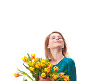 Beautiful young blonde woman with tulips bouquet stock photography