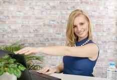 Beautiful young blonde woman using laptop Stock Image