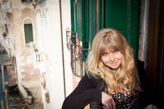 Beautiful young blonde woman in Venice Italy Royalty Free Stock Image