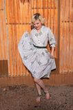 Blonde in a housedress Stock Photography