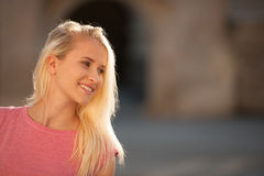 Beautiful young blonde woman on a walk arownd the city near to the castle in summer sunny day Stock Image