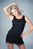 Beautiful young blonde woman wearing black dress Royalty Free Stock Image