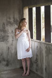 Beautiful Young Blonde Woman with White Dress Stock Images