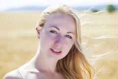 Beautiful young blonde woman. In white dress Royalty Free Stock Images