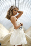 Beautiful young blonde woman in white dress Royalty Free Stock Images