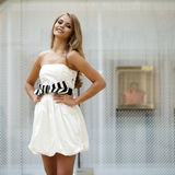 Beautiful young blonde woman in white dress Stock Photos