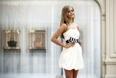 Beautiful young blonde woman in white dress Stock Photo