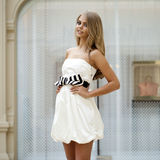 Beautiful young blonde woman in white dress Stock Image
