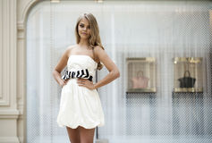Beautiful young blonde woman in white dress Royalty Free Stock Photos