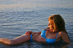 Beautiful young blondie. Beautiful blond woman relaxing in the ocean Stock Image