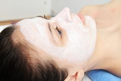 Beautiful young blue eye woman with clay facial mask Royalty Free Stock Images