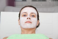 Beautiful young blue eye woman with clay facial mask Stock Photography