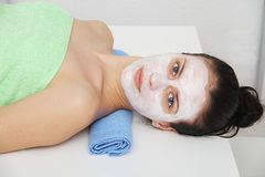 Beautiful young blue eye woman with clay facial mask Royalty Free Stock Photography
