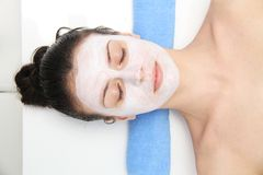 Beautiful young blue eye woman with clay facial mask Stock Images