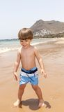 Beautiful young boy playing at the beach Stock Photo