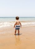 Beautiful young boy playing at the beach Stock Photography