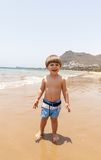 Beautiful young boy playing at the beach Royalty Free Stock Image