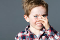 Beautiful young boy playing with his hands for funny face Royalty Free Stock Photos