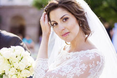 Beautiful young bride  with bouquet from white roses Royalty Free Stock Photo