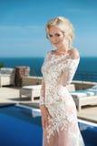Beautiful young bride in elegant wedding dress posing Stock Photo