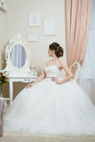 Beautiful young bride in front of the mirror. Stock Photo