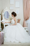 Beautiful young bride in front of the mirror.  Royalty Free Stock Photography
