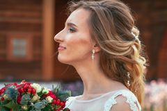 Beautiful young bride in the garden background royalty free stock photos