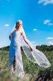 Beautiful young bride in garden Stock Photos