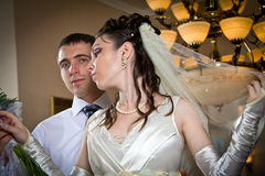 Beautiful young bride with groom Stock Photography
