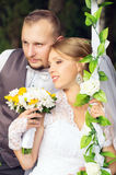 Beautiful young bride and groom Stock Photos