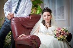 Beautiful young bride and groom indoor setting Royalty Free Stock Images