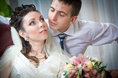 Beautiful young bride and groom in indoor setting Stock Photos