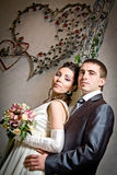 Beautiful young bride and groom in indoor setting Stock Photography