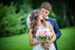 Beautiful young bride and groom Stock Photo