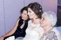 Beautiful young bride  with her mother and grandmother. Portrait of gorgeous  bride posing for photo with her family Royalty Free Stock Photography