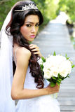 Beautiful young bride holding a bouquet Stock Image