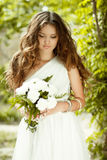 Beautiful young bride holding bouquet of spring fl Royalty Free Stock Photos