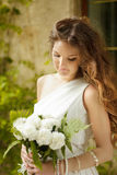 Beautiful young bride holding bouquet of spring flowers with wed Stock Photo