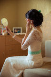 Beautiful young bride at home Royalty Free Stock Image