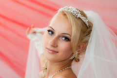 Beautiful young bride keep the veil. Royalty Free Stock Images